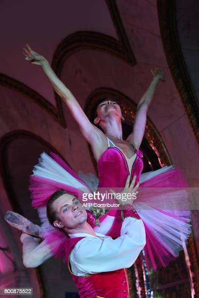 Russian ballet dancers Natalia Balakhnicheva and Yegor Motuzov from 'The Kremlin ballet' troupe perform during a special night performance in the...