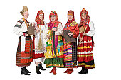 Five women dressed in traditional Russian costumes with instruments.