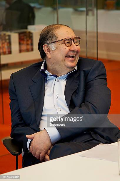 Russian billionaire Alisher Usmanov laughs during a Bloomberg interview in Moscow Russia on Thursday April 25 2013 Usmanov Russia's wealthiest man...