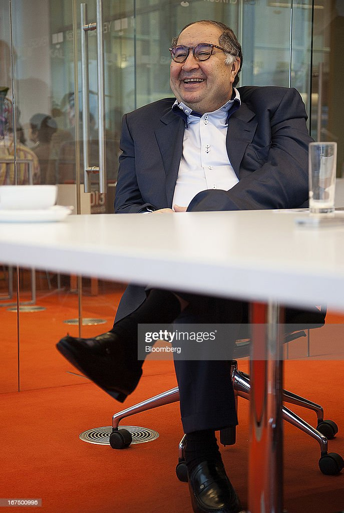 Russian billionaire <a gi-track='captionPersonalityLinkClicked' href=/galleries/search?phrase=Alisher+Usmanov&family=editorial&specificpeople=5595265 ng-click='$event.stopPropagation()'>Alisher Usmanov</a> laughs during a Bloomberg interview in Moscow, Russia, on Thursday, April 25, 2013. Usmanov, Russia's wealthiest man, gave $247 million to charity in the period, a Bloomberg survey of the country's richest people shows. Photographer: Anna Artemeva/Bloomberg via Getty Images