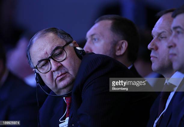 Russian billionaire Alisher Usmanov listens during the opening session on the first day of the World Economic Forum in Davos Switzerland on Wednesday...