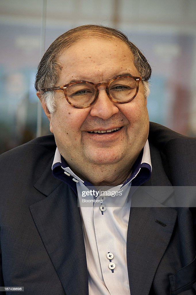 Russian billionaire <a gi-track='captionPersonalityLinkClicked' href=/galleries/search?phrase=Alisher+Usmanov&family=editorial&specificpeople=5595265 ng-click='$event.stopPropagation()'>Alisher Usmanov</a> smiles during a Bloomberg interview in Moscow, Russia, on Thursday, April 25, 2013. Usmanov, Russia's wealthiest man, gave $247 million to charity in the period, a Bloomberg survey of the country's richest people shows. Photographer: Anna Artemeva/Bloomberg via Getty Images