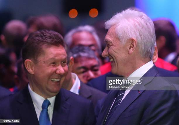 Russian billionaire and businessman Gennady Timchenko and Gazprom's CEO Alexey Miller smile during the first cargo loading ceremony while visiting...