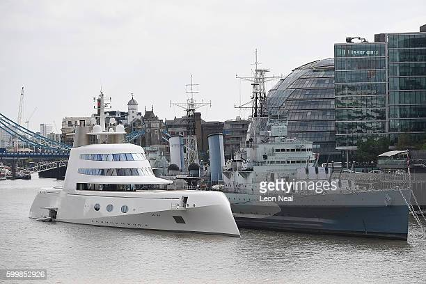 Russian billionaire Andrey Melnichenko's £225m Philippe Starckdesigned boat is seen moored next to HMS Belfast on the River Thames on September 7...