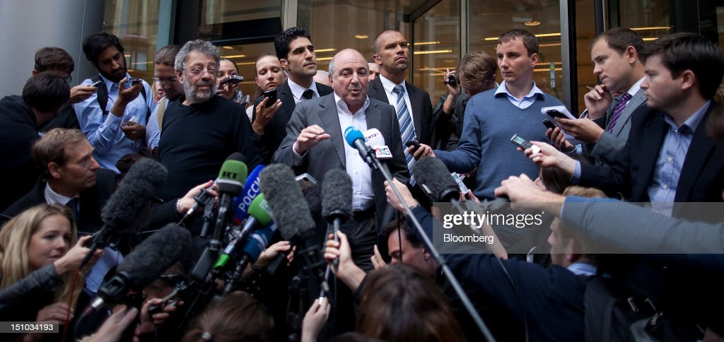 Russian billionaire Boris Berezovsky, center, speaks to the media outside the High Court following today's ruling in London, U.K., on Friday, Aug. 31, 2012. Roman Abramovich won a lawsuit seeking about $6.8 billion over claims he intimidated Berezovsky into selling shares in two Russian oil and metal companies for far less than they were worth. Photographer: Simon Dawson/Bloomberg via Getty Images
