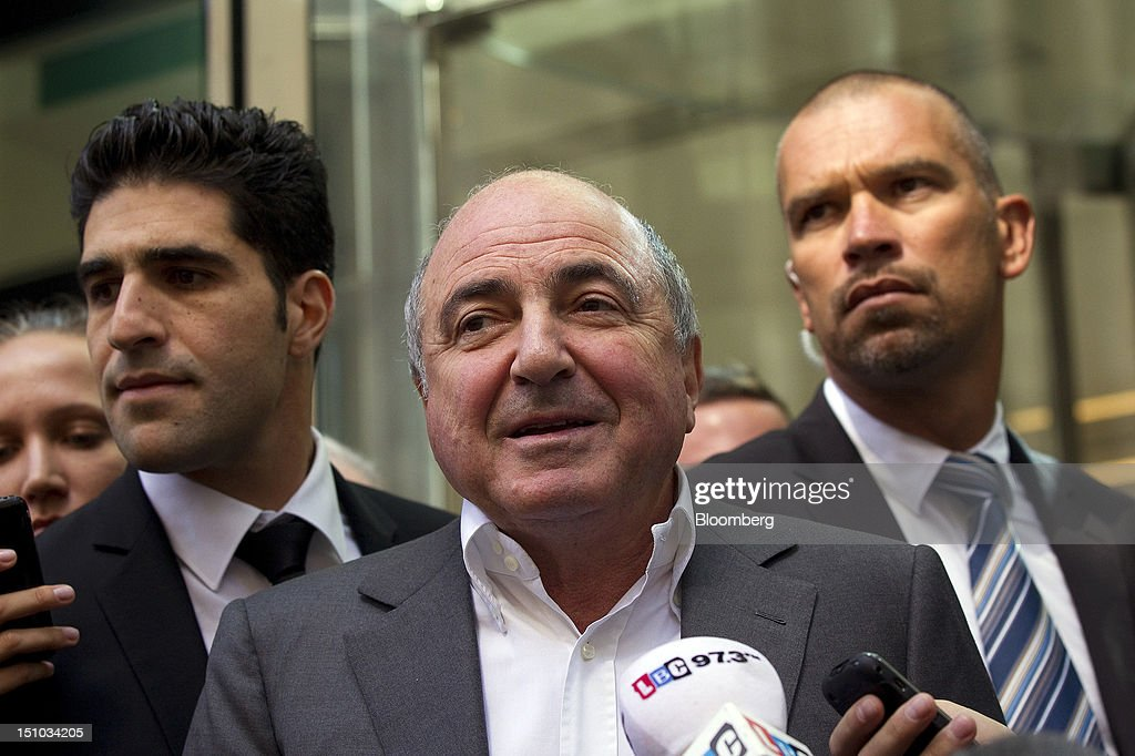 Russian billionaire <a gi-track='captionPersonalityLinkClicked' href=/galleries/search?phrase=Boris+Berezovsky+-+Zakenman&family=editorial&specificpeople=772839 ng-click='$event.stopPropagation()'>Boris Berezovsky</a>, center, speaks to the media outside the High Court following today's ruling in London, U.K., on Friday, Aug. 31, 2012. Roman Abramovich won a lawsuit seeking about $6.8 billion over claims he intimidated Berezovsky into selling shares in two Russian oil and metal companies for far less than they were worth. Photographer: Simon Dawson/Bloomberg via Getty Images