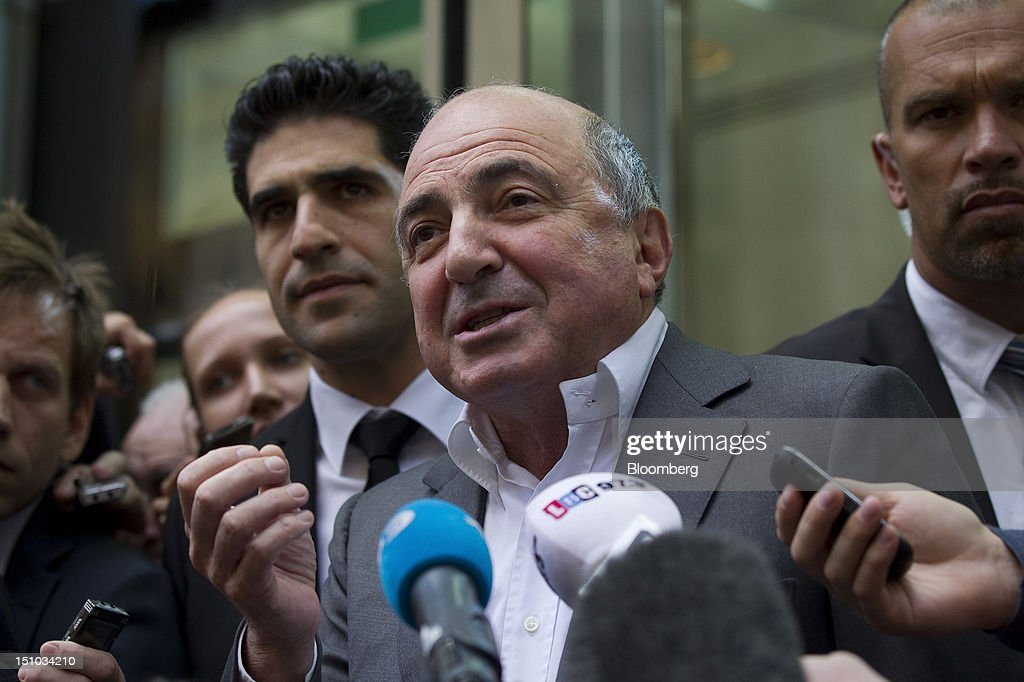 Russian billionaire <a gi-track='captionPersonalityLinkClicked' href=/galleries/search?phrase=Boris+Berezovsky+-+Uomo+d%27affari&family=editorial&specificpeople=772839 ng-click='$event.stopPropagation()'>Boris Berezovsky</a>, center, speaks to the media outside the High Court following today's ruling in London, U.K., on Friday, Aug. 31, 2012. Roman Abramovich won a lawsuit seeking about $6.8 billion over claims he intimidated Berezovsky into selling shares in two Russian oil and metal companies for far less than they were worth. Photographer: Simon Dawson/Bloomberg via Getty Images