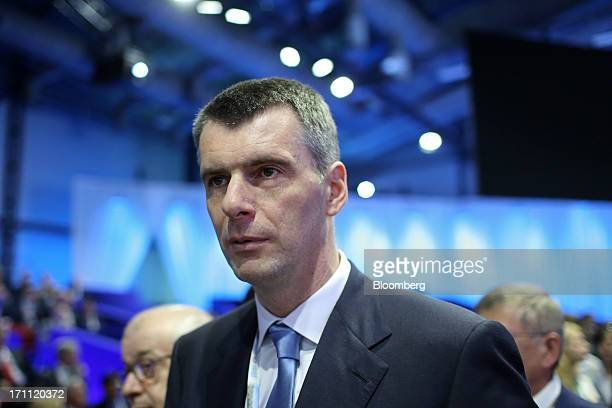 Russian billionaire Mikhail Prokhorov pauses while speaking with the media before a conference session on day two of the St Petersburg International...