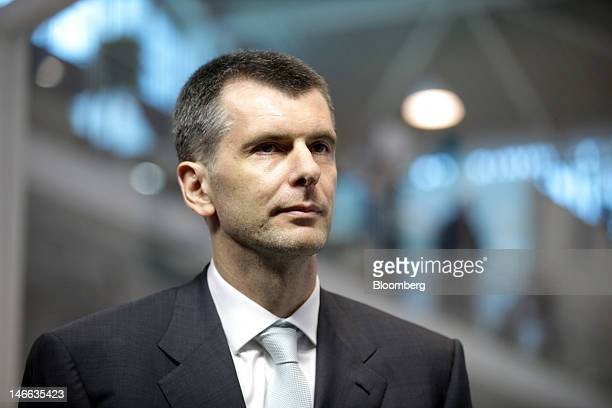 Russian billionaire Mikhail Prokhorov poses for a photograph ahead of a Bloomberg Television interview on day one of the Saint Petersburg...
