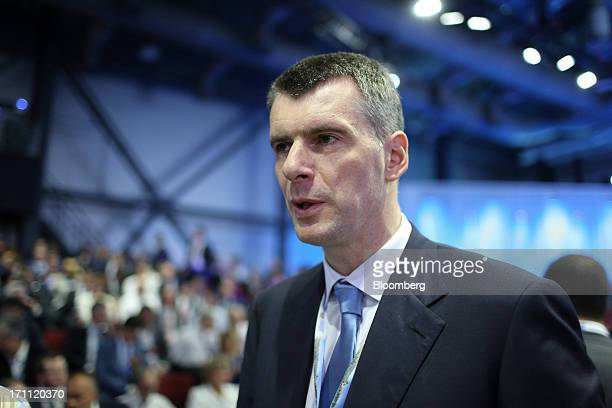 Russian billionaire Mikhail Prokhorov speaks with the media before a conference session on day two of the St Petersburg International Economic Forum...