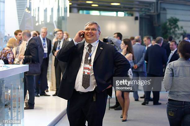 Russian billionaire Mikhail Slipenchuk speaks on a mobile phone between sessions on day two of the St Petersburg International Economic Forum 2013 in...