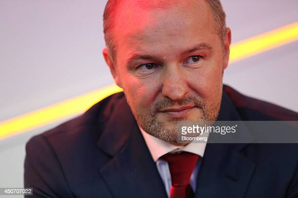 Russian billionaire Roman Trotsenko pauses while talking to a fellow attendee at the OAO Rosneft pavilion during the 21st World Petroleum Congress in...