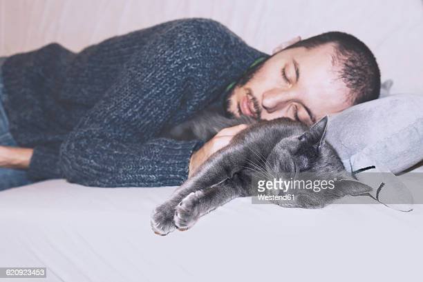 Russian Blue and owner sleeping on the couch