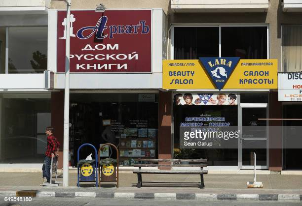 Russian bookstore and a Russian beauty salon stand on March 8 2017 in Limassol Cyprus Cyprus has largely recovered from its 20122013 economic crisis...
