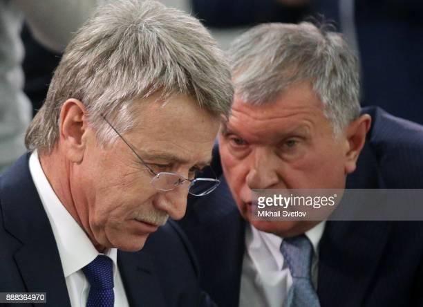 Russian businessman anb billionaire Novatek CEO Leonid Michelson listens Rosneft President Igor Sechin while visiting the LNG plant in Sabetta sea...