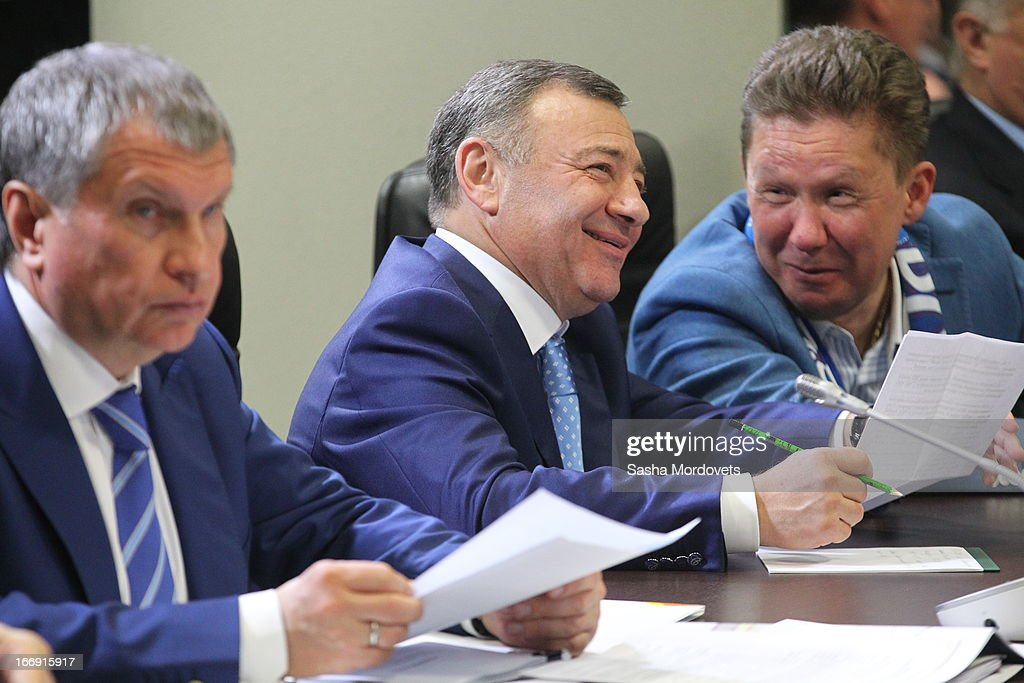 Russian businessman and billionaire Arkady Rotenberg (C), Gazpom's CEO <a gi-track='captionPersonalityLinkClicked' href=/galleries/search?phrase=Alexei+Miller&family=editorial&specificpeople=713081 ng-click='$event.stopPropagation()'>Alexei Miller</a> (R) and Rosneft's oil company President <a gi-track='captionPersonalityLinkClicked' href=/galleries/search?phrase=Igor+Sechin&family=editorial&specificpeople=756791 ng-click='$event.stopPropagation()'>Igor Sechin</a> (L) during the openings of the 2013 IIHF U18 World Junior Championship on April 18, 2013 in Sochi, Russia.