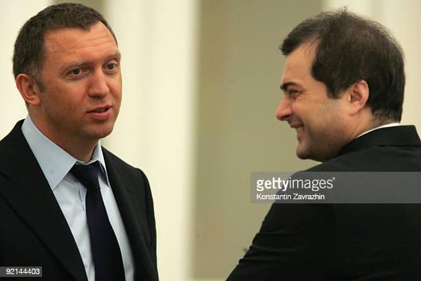 Russian businessman and billionaire Oleg Deripaska and main Kremlin's ideologist Vladislav Surkov speak prior to attending a meeting amongst other...