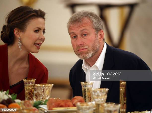 Russian businessman and billionaire Roman Abramovich listens to Polina Deripaska the wife of billionaire Oleg Deripaska during the reception at the...