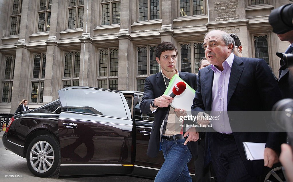 Russian businessman <a gi-track='captionPersonalityLinkClicked' href=/galleries/search?phrase=Boris+Berezovsky+-+Businessman&family=editorial&specificpeople=772839 ng-click='$event.stopPropagation()'>Boris Berezovsky</a> (R) arrives at The High Court on October 4, 2011 in London, England. Mr Berezovsky is alleging a breach of contract over business deals with fellow Russian and Chelsea Football Club owner Roman Abramovich and is claiming more than £3.2bn in damages.