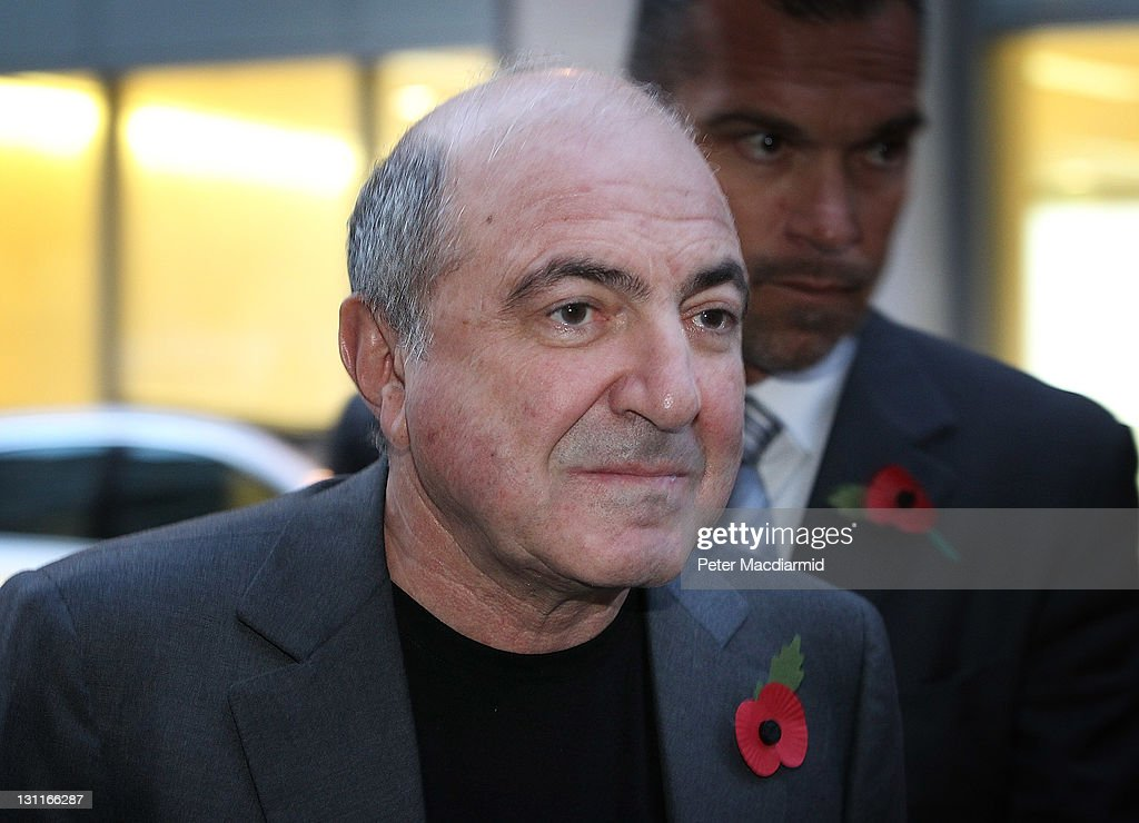 Russian businessman <a gi-track='captionPersonalityLinkClicked' href=/galleries/search?phrase=Boris+Berezovsky+-+Businessman&family=editorial&specificpeople=772839 ng-click='$event.stopPropagation()'>Boris Berezovsky</a> (C) leaves The High Court with his partner Yelena Gorbunova (L) on November 2, 2011 in London, England. Mr Berezovsky is alleging breach of trust and breach of contract over business deals with Chelsea Football Club owner Roman Abramovich and is claiming more than £3.2bn in damages.