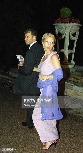 Russian businessman Roman Abramovich and his wife Irina Malandina make their way to the Elton John Charity Concert at the Yekaterinisky Palace July...