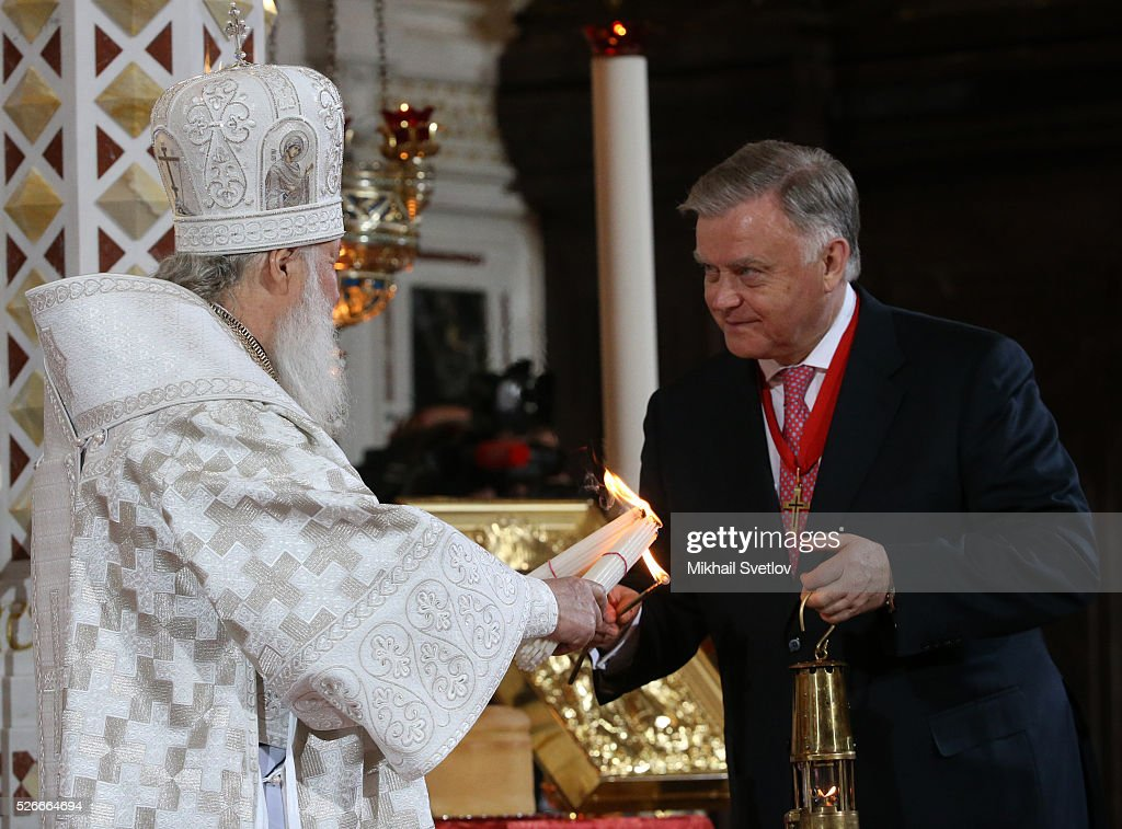 Russian businessman Vladimir Yakunin (R), holding a candle and Orthodox Patriarch Kirill (L) seen during the Orthodox Easter mass at the Christ The Saviour Catherdal, in Moscow, Russia, May,1, 2016. Russian President Vladimir Putin, Moscow Mayor Sergei Sobyanin, Prime Minister Dmitry Medvedev and his wife Svetlana took part an Orthodox Easter service held by Patriarch Kirill at the biggest Russian Orthodox Cathedral.