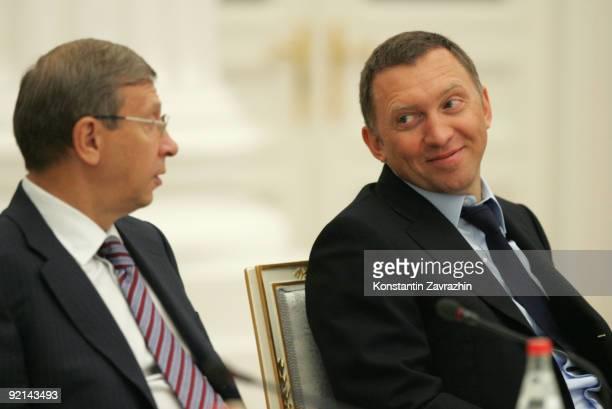Russian businessmen and billionaires Vladimir Yevtushenkov and Oleg Deripaska attend a meeting amongst other business leaders with President Dmitry...