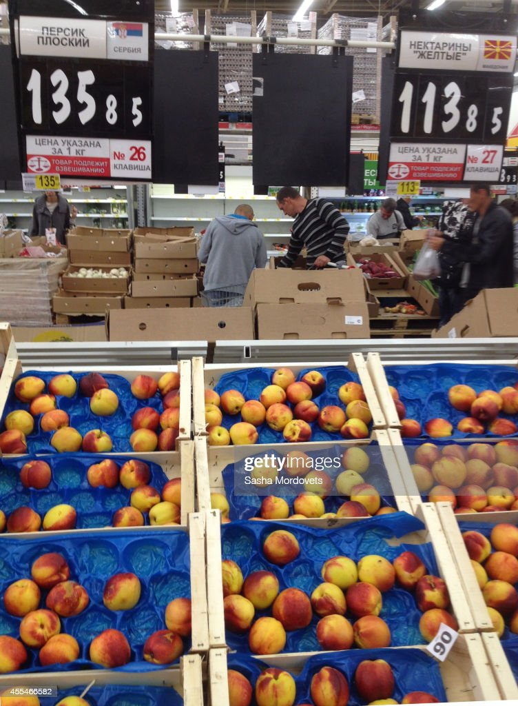 Russian buyers shop for peaches from Serbia and Nectarines from the Republic of Macedonia in an Auchan store September 14, 2014 in Moscow, Russia. The Russian government has banned fruits and vegetables imports from European Union countries in response to Western sanctions imposed over the Ukrainian crisis.