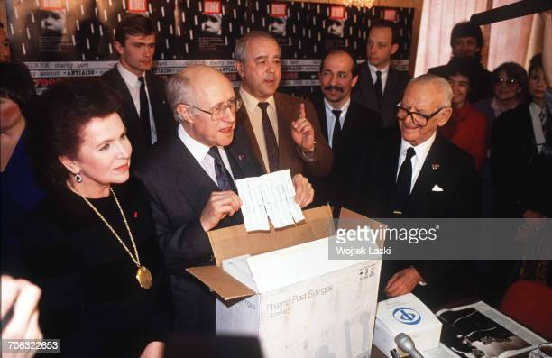 Russian cellist and conductor Mstislav Rostropovich and his wife Galina Vishnevskaya show the disposable medical syringes which they had brought as a...