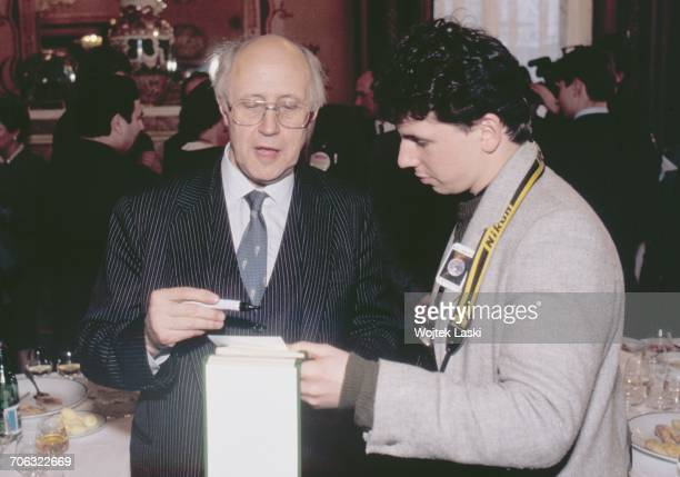 Russian cellist and conductor Mstislav Rostropovich signing an autograph in Moscow Russia on March 13th 1990