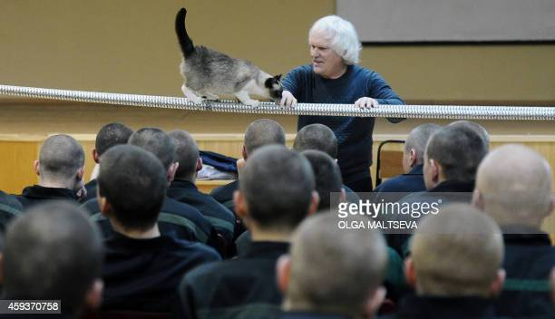 Russian clown and cat trainer Yuri Kuklachev performs during a visit to the juvenile prison in Kolpino outside St Petersburg on November 21 2014 AFP...