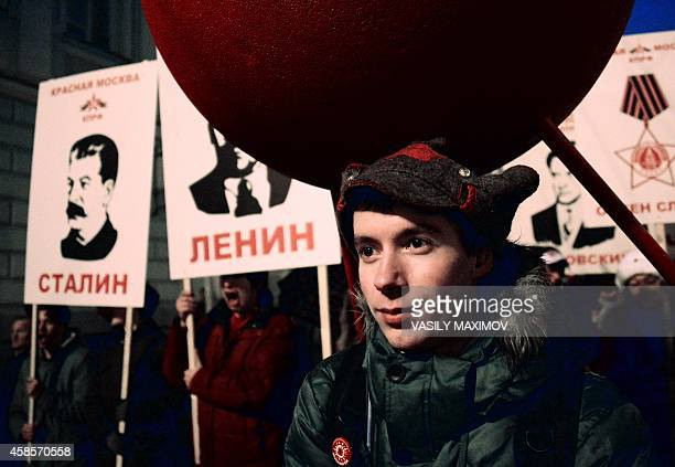 A Russian communist party activist attends a rally to mark the 97th anniversary of the 1917 Russia's Bolshevik Revolution in central Moscow on...