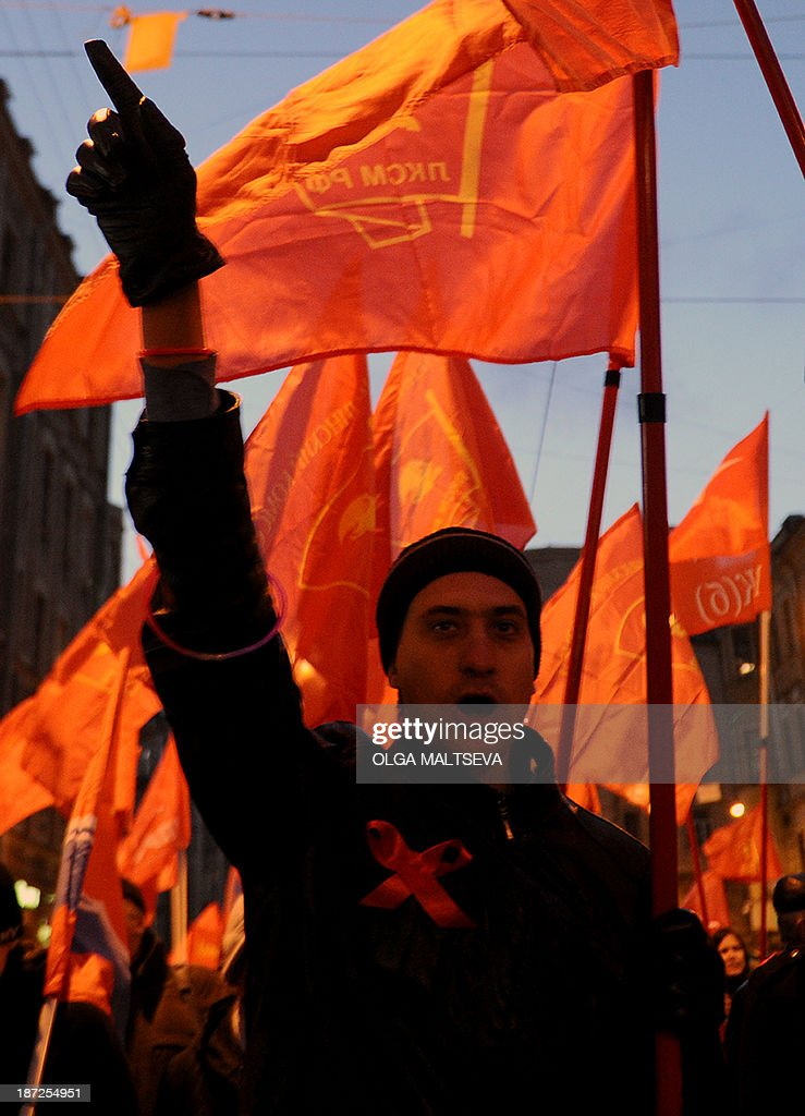 Russian communist party activists and supporters rally to mark the 96th anniversary of the 1917 Russia's Bolshevik Revolution in central Saint-Petersburg on November 7, 2013.