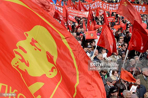 Russian communist party activists carry red flags and banners during their traditional May Day rally in central Moscow on May 1 2013 AFP PHOTO /...