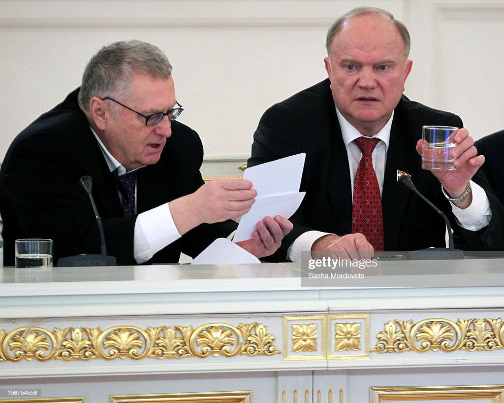 Russian Communist Party Leader <a gi-track='captionPersonalityLinkClicked' href=/galleries/search?phrase=Gennady+Zyuganov&family=editorial&specificpeople=213936 ng-click='$event.stopPropagation()'>Gennady Zyuganov</a> (R) and Liberal Democracy Party (LDPR) Leader <a gi-track='captionPersonalityLinkClicked' href=/galleries/search?phrase=Vladimir+Zhirinovsky&family=editorial&specificpeople=210599 ng-click='$event.stopPropagation()'>Vladimir Zhirinovsky</a> (L) attend a State Council meeting at Grand Kremlin Palace on December 27, 2012 in Moscow, Russia. During the meeting Russian President Vladimir Putin said that he will sign a bill that will ban Americans from adopting Russian children.
