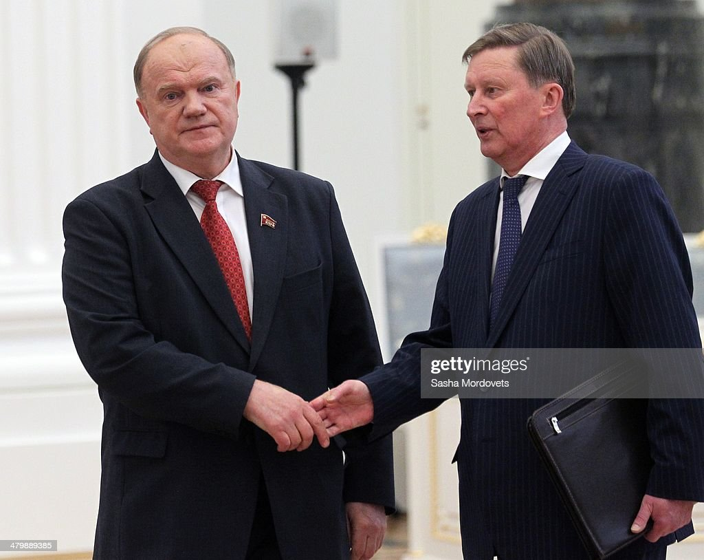 Russian Communist Party Leader Gennady Zyuganov and Presidential Chief of Staff Sergei Ivanov attend the signing of final decree completing...