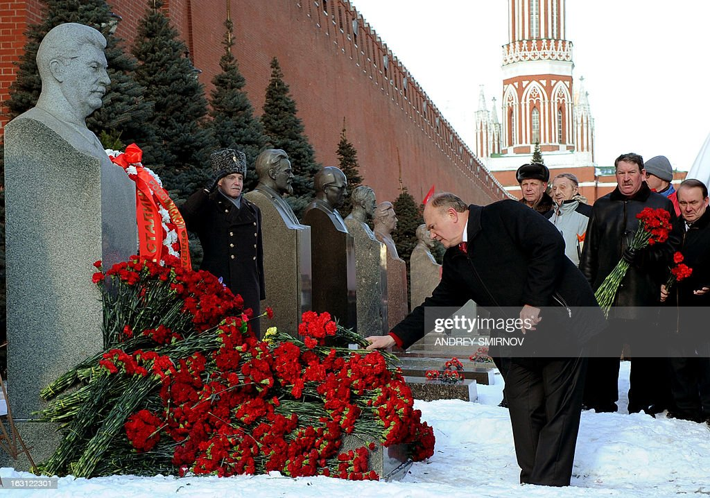 Russian Communist Party leader Gennady Zyuganov lays flowers at the tomb of Soviet dictator Josef Stalin at the Red Square in Moscow on March 5, 2013, to mark the 60th anniversary of Stalin's death. Russia marks today 60 years since the death of Stalin with attitudes split about whether to view him as a tyrant who slaughtered millions or a national saviour who helped turn the country into a global superpower that emerged victorious in World War II. AFP PHOTO / ANDREY SMIRNOV