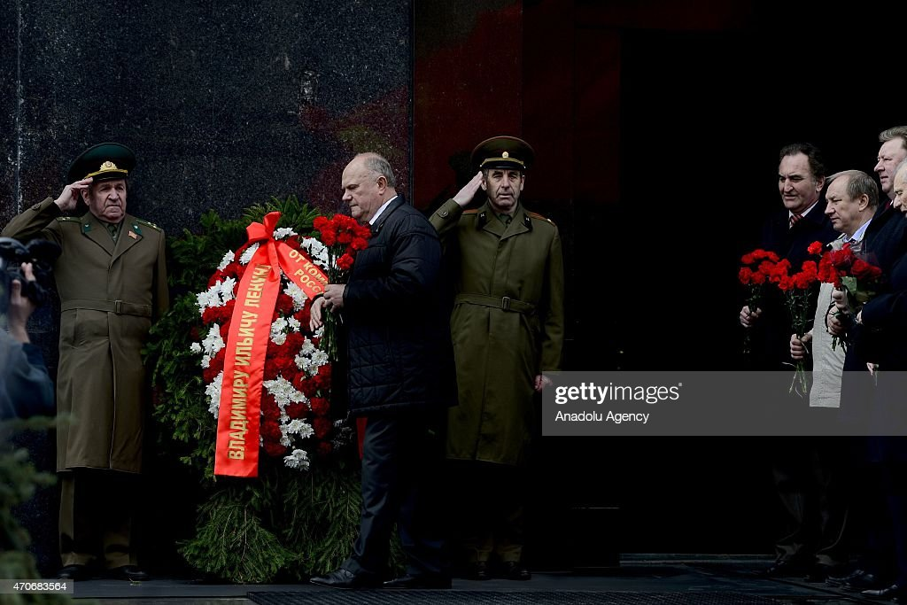 Russian Communist Party Leader <a gi-track='captionPersonalityLinkClicked' href=/galleries/search?phrase=Gennady+Zyuganov&family=editorial&specificpeople=213936 ng-click='$event.stopPropagation()'>Gennady Zyuganov</a> (L 2) walks at Moscow's Red Square after laying flowers at Soviet founder Vladimir Lenin's Mausoleum on Lenin's birthday, on April 22, 2015 in Moscow, Russia.