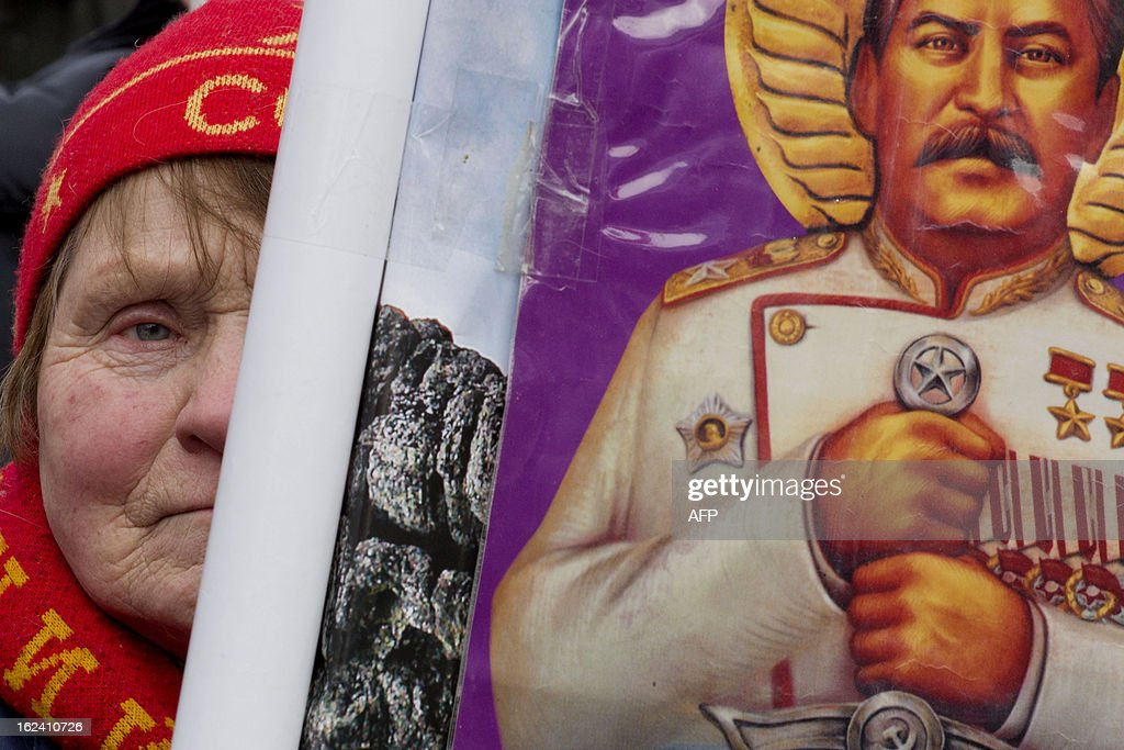A Russian communist party supporter holds a picture of Josef Stalin during a rally devoted to the Defenders of the Fatherland day holiday in Moscow, on February 23, 2013. The Defenders of the Fatherland Day, celebrated in Russia on February 23, honors the nation's military and is a nationwide holiday.