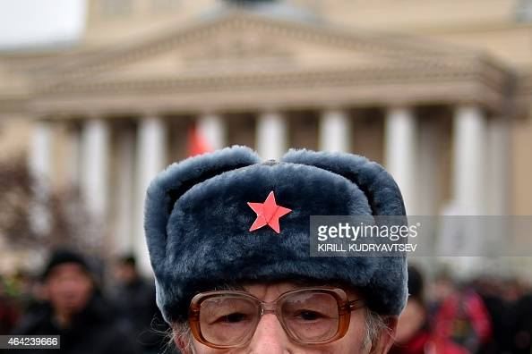 A Russian Communist party supporter takes part in a rally devoted to the Defender of the Fatherland in Moscow on February 23 2013 The Defender of the...