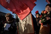 Russian Communist Party supporters carry a portrait of late Soviet leader Vladimir Lenin as they take part in a memorial ceremony to mark the 91st...