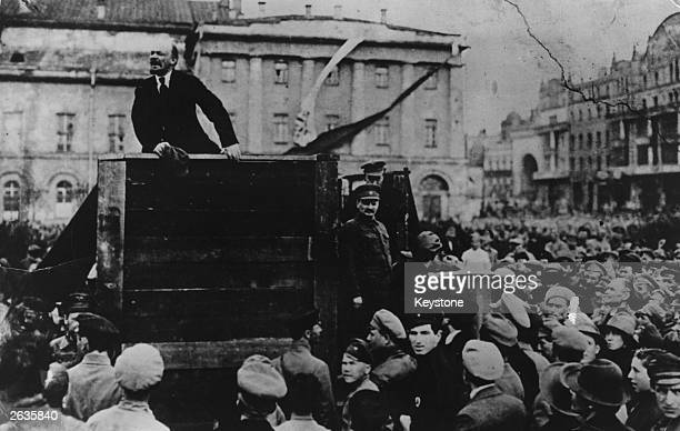 Vladimir Ilyich Lenin addresses a huge crowd in Sverdlov Square Moscow Russian activist Leon Trotsky is standing on the right of the podium