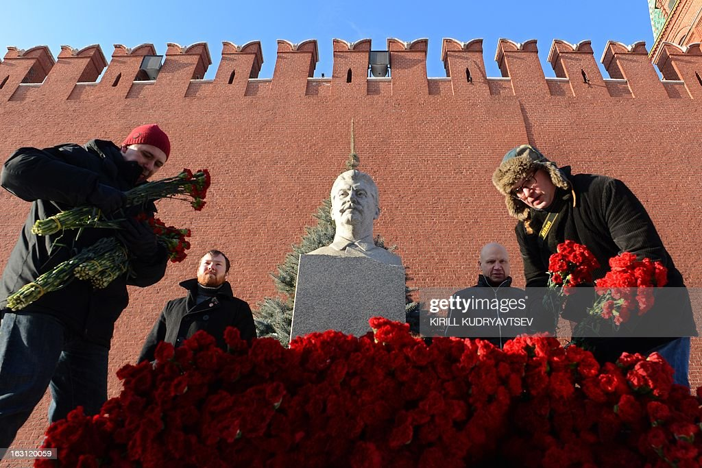Russian Communists and their supporters lay flowers at the tomb of Soviet dictator Josef Stalin to mark the 60th anniversary of his death at the Red Square in Moscow on March 5, 2013. Russia marks today 60 years since the death of Stalin with attitudes split about whether to view him as a tyrant who slaughtered millions or a national saviour who helped turn the country into a global superpower that emerged victorious in World War II.