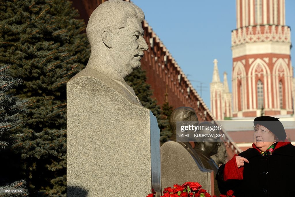 Russian Communists and their supporters lay flowers at the tomb of Soviet dictator Josef Stalin to mark the 60th anniversary of his death at the Red Square in Moscow on March 5, 2013. Russia marks today 60 years since the death of Stalin with attitudes split about whether to view him as a tyrant who slaughtered millions or a national saviour who helped turn the country into a global superpower that emerged victorious in World War II. AFP PHOTO / KIRILL KUDRYAVTSEV
