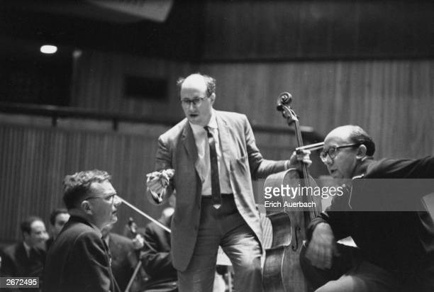 Russian composer and pianist Dmitri Shostakovich right discusses his Cello Concerto with German conductor Gennady Rozhdestevensky of the Leningrad...