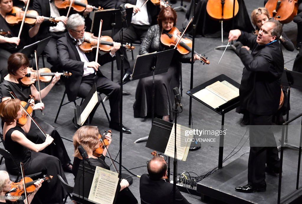 Russian conductor and Artistic Director of the Ural Philharmonic Orchestra Dmitri Liss (R) leads the orchestra during the 'Folle Journee de Nantes' classical music festival in Nantes, western France, on February 5, 2016. / AFP / LOIC