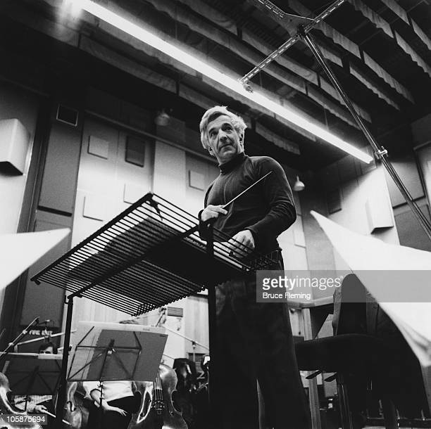 Russian conductor and pianist Vladimir Ashkenazy conducts the Royal Philharmonic Orchestra at Abbey Road Studios London circa 1988