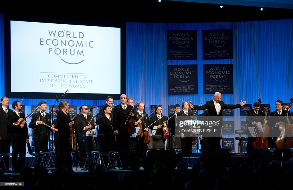 Russian conductor Vladimir Spivakov (R) and the Moscow Virtuosi Chamber orchestra receive applause at the opening ceremony of the World Economic Forum (WEF) at the congress center on January 22, 2013 at the Swiss resort of Davos. Reviving the global economy and the conflicts in Syria and Mali will top the agenda as world leaders and business chiefs meet this week in the Swiss ski resort of Davos for its annual gathering of international power brokers.
