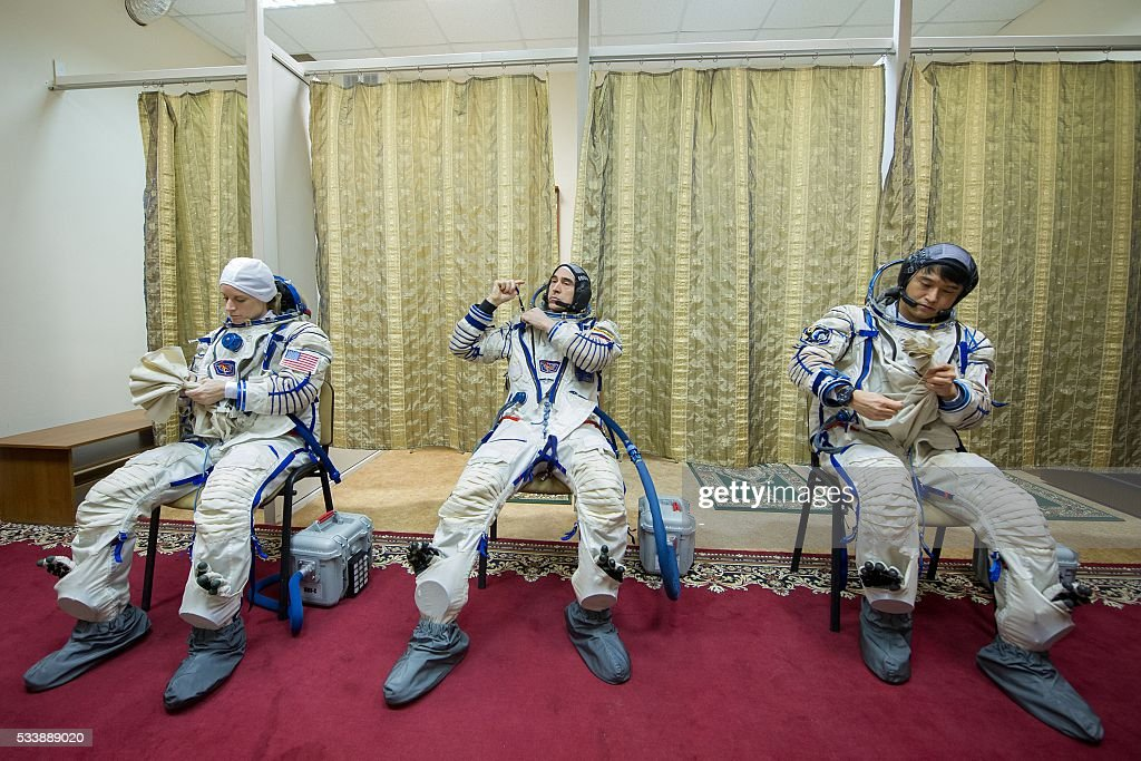 Russian cosmonaut Anatoli Ivanishin (C), Japanese JAXA astronaut Takuya Onishi (R) and US NASA astronaut Kate Rubins attend a training session at the Gagarin Cosmonauts' Training Centre in Star City, outside Moscow, on May 24, 2016. The crew is to take off from Kazakhstan's Baikonur cosmodrome to the International Space Station (ISS) on June 24, 2016. / AFP / -