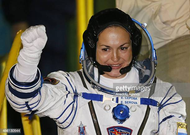 Russian cosmonaut Elena Serova member of expedition to the International Space Station waves during farewell ceremony as they get up into the...